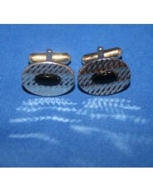abotoaduras p punho de camisa, com formato oval, metal dourado, com preto ao meio,perfeito estado.Peças de 1990.