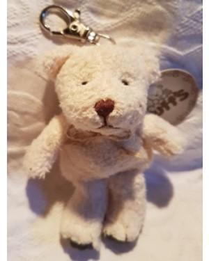 ursinho urso  Puffs ,pelúcia, vem dentro de uma latinha, quase novo, tem dispositivo para dependurar,cor branca, ainda c a etiqueta de fábrica.